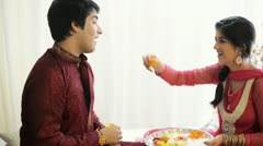 Teenage girl feeding sweet to her brother at Raksha Bhandan festival Stock Footage