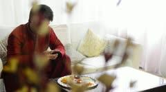 Pan shot of a man text messaging on a mobile phone at Raksha Bhandan festival Stock Footage