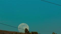 4K UHD NTSC  wide Supermoon 2013 rising over ridge near Tucson AZ Time Lapse - stock footage