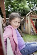 Stock Photo of germany, north rhine westphalia, cologne, girl sitting on bench at playground