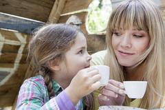 Stock Photo of germany, north rhine westphalia, cologne, mother and daughter drinking tea, s