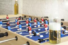 Stock Photo of tablefootball with beer bottles