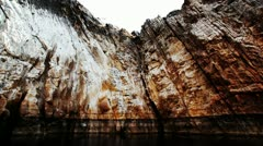 Tracking shot of cliffs along the river Stock Footage