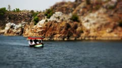 Pan shot of tourists enjoying boat riding Stock Footage