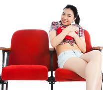 attractive asian girl 20s at the theatre isolate white background - stock photo