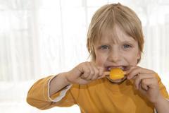 austria, boy eating icecream - stock photo