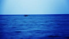 Pan shot of a boat moving in the sea Stock Footage