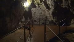 Tourist Exploring a Mountain Cave, Explorer Cave, People Traveling Stock Footage