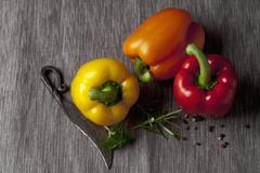 Capsicum with knife and peppers, close up Stock Photos