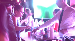 Young Hip People Partying - Bartenders at Concert Venue - stock footage