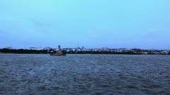 Pan shot of the city at Hussain Sagar Lake Stock Footage