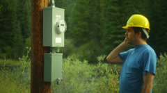 Electric company power line construction phone 1 Stock Footage