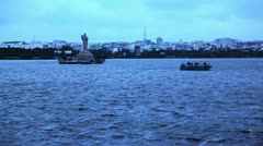 Locked-on shot of tourists enjoying boat riding in Hussain Sagar Lake Stock Footage