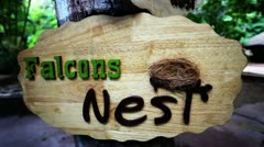 Tilt up shot of wooden sign boards Stock Footage