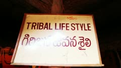 Shot of a signboard with statues representing tribal lifestyle Stock Footage