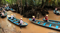 Boat taxi for tourists on a canal in Mekong, Vietnam Stock Footage