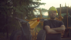 Road construction blue collar worker hard hat smile at Stock Footage