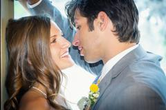 Usa, texas, bride and groom standing face to face, smiling Stock Photos