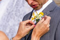 Usa, texas,  future mother in law adjusting boutonniere at grooms suit Stock Photos