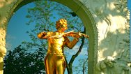 Stock Video Footage of The gilded bronze monument of Johann Strauss II