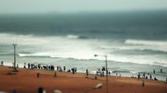 Locked-on shot of tourists on the Ramakrishna Beach Stock Footage