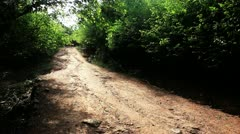 Locked-on shot of a dirt road at Kambalakonda Park Stock Footage