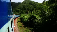 Tracking shot of a train moving in the Araku Valley Stock Footage
