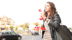 Young adult woman dialing and speaking on vintage obsolete red phone Stock Footage