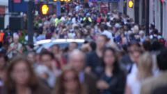 Anonymous Crowd of people walking on city street sidewalk - stock footage