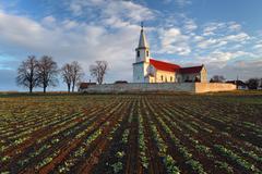 Stock Photo of nice catholic church in eastern europe - village pac