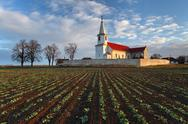 Stock Photo of nice catholic church in eastern europe - village pac