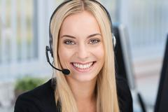 smiling woman wearing a headset - stock photo