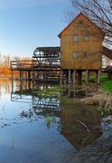 historic wooden watermill with reflection. - stock photo