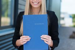 Woman holding her curriculum vitae Stock Photos
