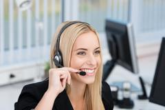 friendly call centre operator or receptionist - stock photo
