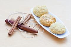 Biscuits on a plate and cinnamon sticks Stock Photos