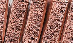 Stock Photo of aerated porous chocolate as a background