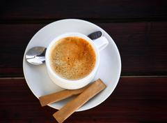 White cup of freshly brewed coffee with sugar Stock Photos