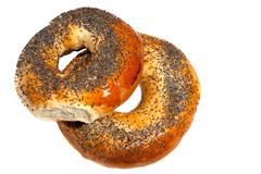 Bagels with poppy seeds isolated on white background Stock Photos