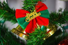 Christmas bell hanging on the christmas tree Stock Photos