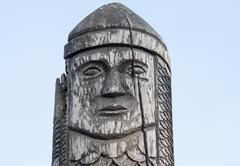 wooden statue of the ancient pagan god - stock photo