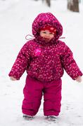 Baby walk by snow near winter park Stock Photos