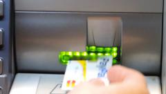 ATM cash machine, slot, credit card, close up. Stock Footage