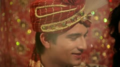Pan Shot of a smiling Indian newlywed couple Stock Footage