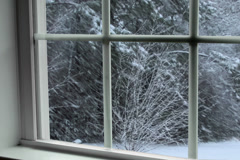 Winter snow storm in wooded area seen through window - stock footage