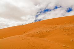 Climbing the Big Daddy in Sossusvlei, Namibia Stock Photos
