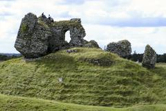 castle ruins with men - stock photo