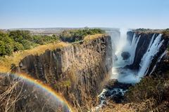 Victoria Falls and Victoria Falls Bridge with rainbow Stock Photos