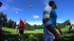 Rugby players catch the ball Stock Footage