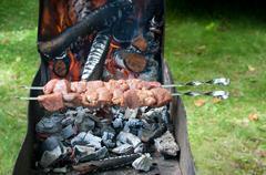 preparation of shashlik outdoor - stock photo